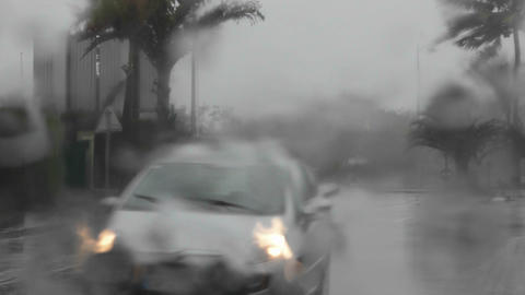 Cars drive through a big rainstorm from the POV th Stock Video Footage