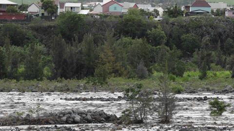 A river rages during a big storm Footage