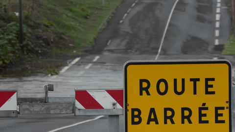 A road sign in French indicates that the road is c Stock Video Footage