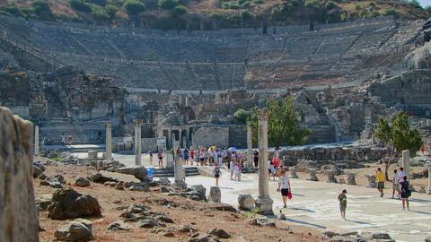 Tourists walk near the Coliseum at Ephesus, Greece Stock Video Footage