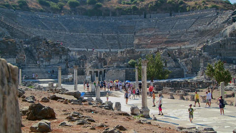 Tourists walk near the Coliseum at Ephesus, Greece Stock Video Footage