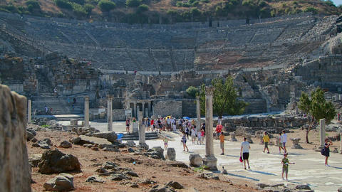 Tourists walk near the Coliseum at Ephesus, Greece Footage