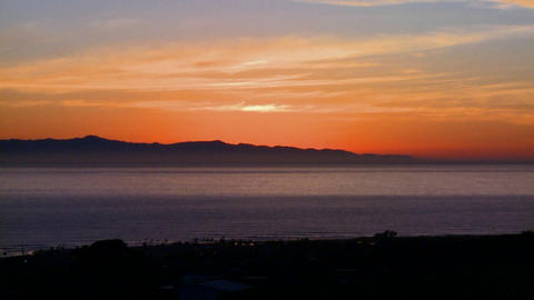The sun sets behind the Channel Islands in Souther Stock Video Footage