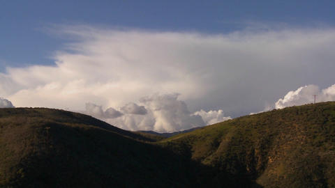 Gorgeous clouds behind a mountain along California Footage