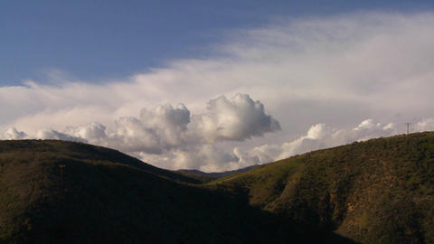 Gorgeous clouds behind a mountain along California Stock Video Footage