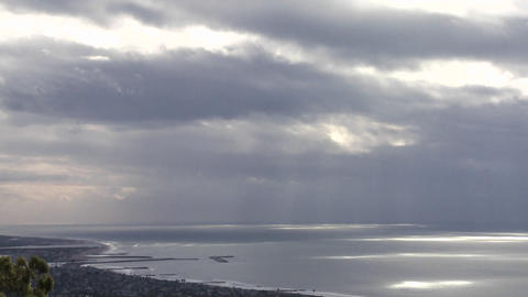 Pockets of light and shadow move across the ocean Stock Video Footage