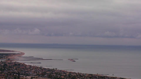A storm front moves over the coast in this time la Footage