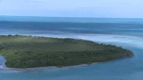 An aerial shot over a Caribbean lagoon Footage