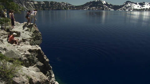 People jump into the waters of Crater Lake, Oregon Footage