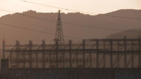 High tension power lines in sunset light Stock Video Footage