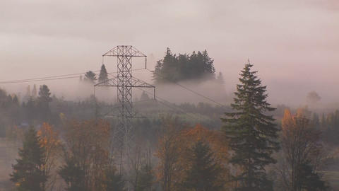 High tension power lines in the fog Stock Video Footage