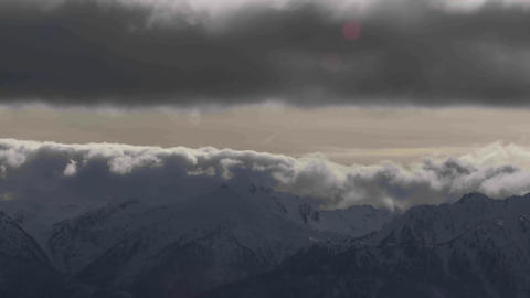 A beautiful time lapse shot of fog and clouds roll Stock Video Footage