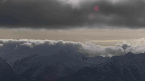 A beautiful time lapse shot of fog and clouds roll Footage