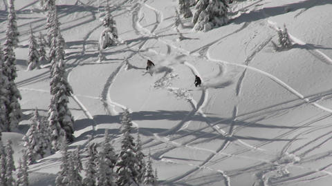 A skier skis through deep snow in the backcountry Footage