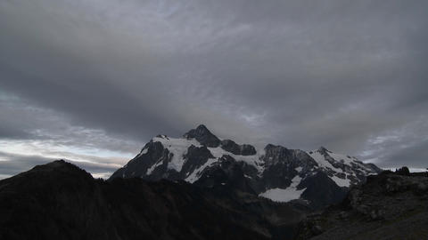 Winter clouds in time lapse over a mountain peak Stock Video Footage