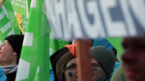 Environmental activists march in a parade on Earth Footage