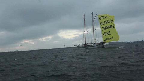 A ship with a flag proclaims an end to global warm Footage