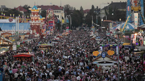 Overview of huge crowds at an amusement park Stock Video Footage