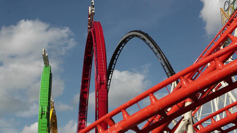 A roller coaster goes around a looping track at an Stock Video Footage