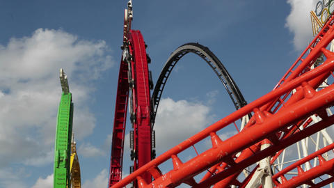 A Roller Coaster Goes Around A Looping Track At An stock footage