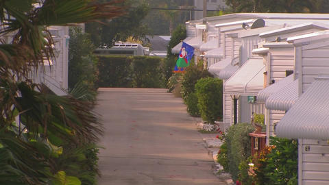 Rows of homes near a walking path at a trailer par Stock Video Footage