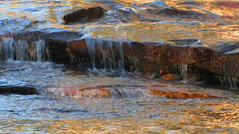 Water flows over flat rocks at Tuolumne Meadows in Stock Video Footage
