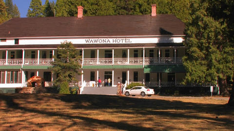 A car drives to the front of the Wawona Hotel at Y Live Action