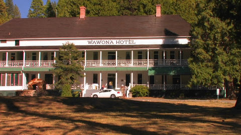 A car drives to the front of the Wawona Hotel at Y Stock Video Footage