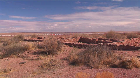 A train passes near ruins in the New Mexico desert Stock Video Footage