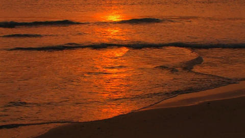 A reflection of the sunset over beach waves breaki Stock Video Footage