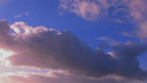 Clouds at sunset moving over a blue sky Stock Video Footage
