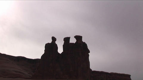 People climb across a rock formation Stock Video Footage