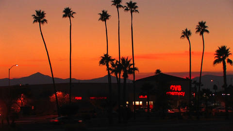 A multi-colored sunset behind the silhouette of a Stock Video Footage