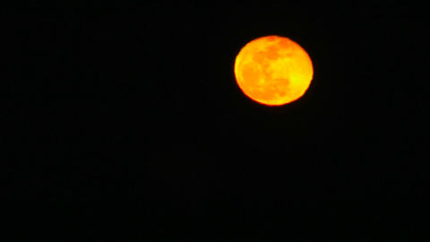 A time lapse of the yellow and orange moon Stock Video Footage