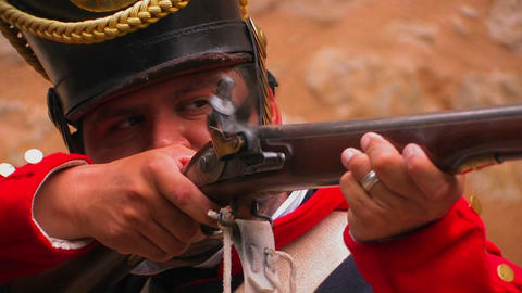 A soldier fires a musket at a reenactment of the B Footage