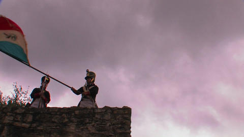 A soldier waves the Flag of Mexico at a reenactmen Footage