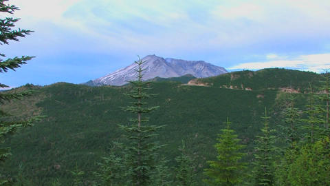 A mountain peak rises above a forest at Mt. St. He Stock Video Footage