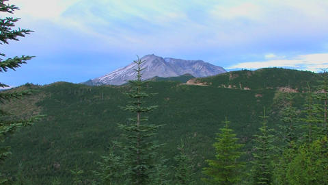 A mountain peak rises above a forest at Mt. St. He Footage