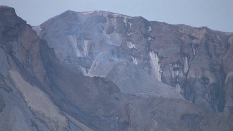 Smoke rises from a rocky mountain at Mt. St. Helen Footage