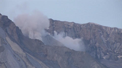 Smoke emits from a rocky mountain Live Action