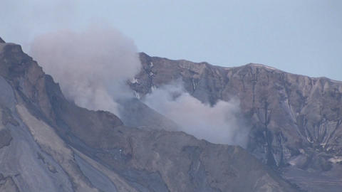 Smoke emits from a rocky mountain Stock Video Footage