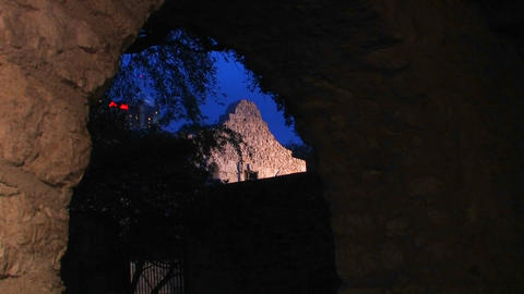 A stone wall is seen through a brick archway in Sa Footage