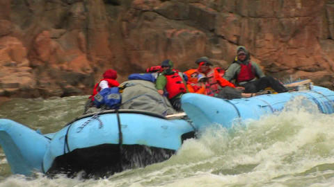 A rafting expedition heads down the Colorado River Stock Video Footage
