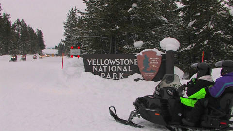 Snowmobiles enter Yellowstone National Park Stock Video Footage