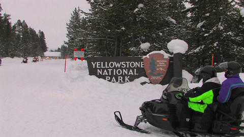 Snowmobiles enter Yellowstone National Park Footage