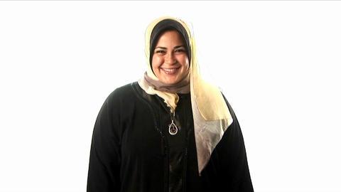 A woman wears a headscarf Stock Video Footage