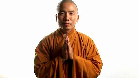 A Buddhist monk wearing an orange robe Stock Video Footage
