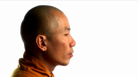 A Buddhist monk wearing an orange robe Footage
