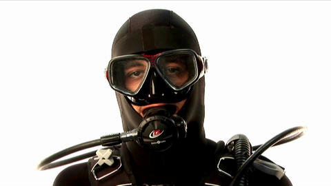 A scuba diver gives two thumbs up on land Stock Video Footage