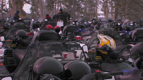 Many snowmobiles are lined up in a snowmobile park Stock Video Footage